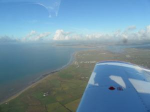 Clear of cloud with Caernarfon off the wing